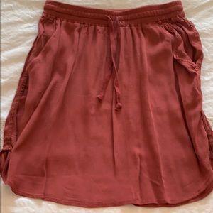Flowy drawstring mini-skirt.